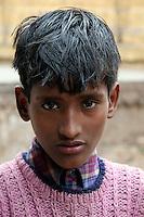 QS050123Varanasi014 20050123 VARANASI,INDIA:.Portrait of a young boy in Varanasi, India 23 January, 2005. QS050123Varanasi040 20050123 VARANASI,INDIA:.Portrait of a young girl with her pet dog in Varanasi, India 23 January, 2005.