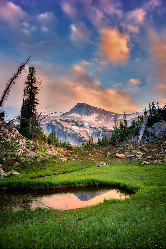 Small pond reflecting Eagle Cap Mountain and sunset clouds. Eagle Cap wilderness, Oregon