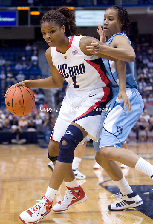 HARTFORD, CT - 22 NOVEMBER 2008 -112208JT08-<br /> UConn's Tahirah Williams dribbles past Rhode Island's Sierra Cooper during Saturday's game at the XL Center in Hartford. The Huskies won, 91-43.<br /> Josalee Thrift / Republican-American