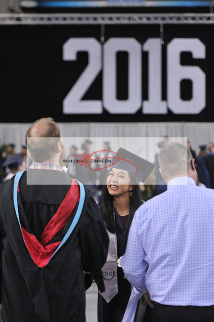 Esther Min greets a faculty member at the Eagle River High School commencement Monday May 9, 2016.  Photo for the Star by Michael DInneen