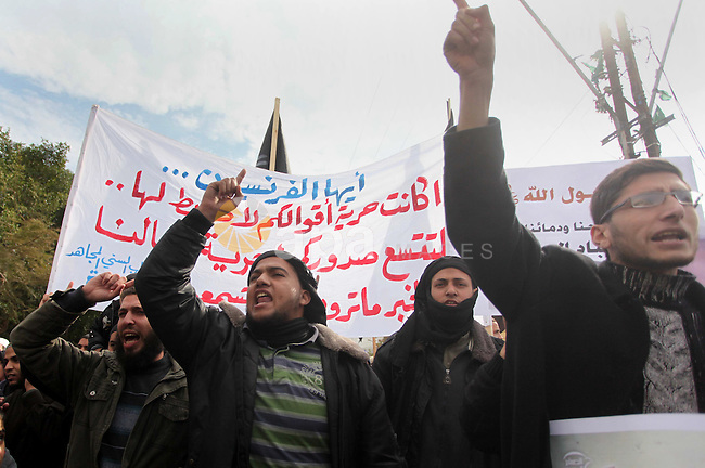 Palestinian Salafists shout during a protest against satirical French weekly magazine Charlie Hebdo's cartoons of the Prophet Mohammad, in Gaza city January 19, 2015. Dozens of Jihadist Salafi men rallied in Gaza on Monday to condemn continued publication by French satirical magazine Charlie Hebdo of cartoons deemed offensive to Islam's Prophet. Charlie Hebdo published a picture of Mohammad weeping on its cover last week after gunmen stormed its offices in Paris, killing 12 people. The gunmen said the attack was revenge for cartoons the magazine had published mocking Islam. Photo by Ashraf Amra