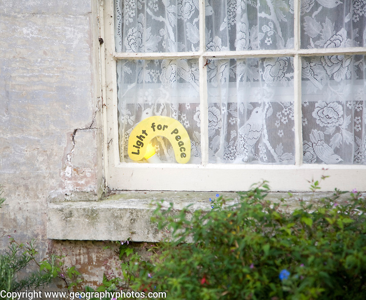 Light for Peace showing in window of house Bath, Somerset, England
