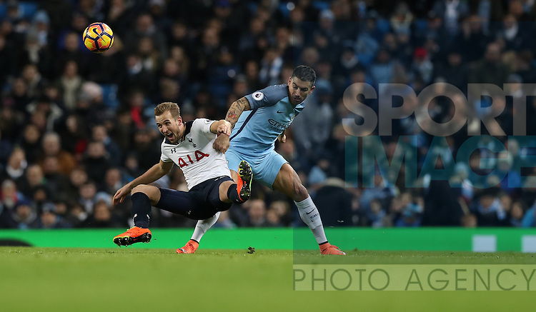 Aleksandar Kolarov of Manchester City and Harry Kane of Tottenham Hotspur during the Premier League match at Etihad Stadium, Manchester. Picture date: January 21st, 2017.Photo credit should read: Lynne Cameron/Sportimage