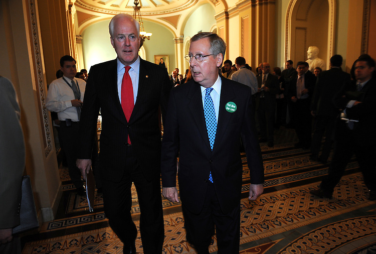 Senate Minority Leader Mitch McConnell, R-Ky., right, and Sen. John Cornyn, R-Texas, walk to the McConnell's office after addressing the media, July 15, 2008.