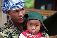 A village that is flooded during the Monsoon Season near the Tonle Sap Lake, Cambodia Father and Son,
