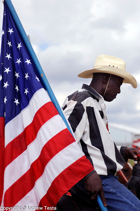 USA. Angola. 12th October 2008..A prisoner carrying the Stars and Stripes waits to enter the arena..©Andrew Testa/Panos