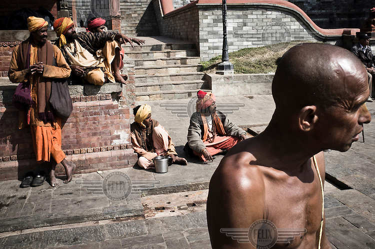 A group of Sadhus begging outside the Pashupathinath Temple.
