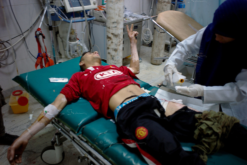 Tripoli, Libya, August 25, 2011.Hyman, 21, has received a bullet in the leg, he is treated in the Hospital I C U. .Tripoli central hospital operates under very difficult circumstances, lacking personnel and supplies such as medecines, oxygen and dressings.