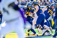 Morgantown, WV - NOV 10, 2018: West Virginia Mountaineers running back Alec Sinkfield (20) runs through traffic for a first quarter first down during game between West Virginia and TCU at Mountaineer Field at Milan Puskar Stadium Morgantown, West Virginia. (Photo by Phil Peters/Media Images International)