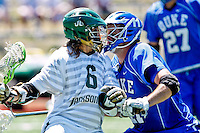 April 30, 2011:  Jacksonville Dolphins midfielder Robert Moore (6) and Duke Blue Devils defender Tom Montelli (11) lock helmets during lacrosse action between the Duke Blue Devils and Jacksonville Dolphins at D. B. Milne Field in Jacksonville, Florida.  Duke defeated Jacksonville 10-6.