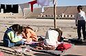 Iraq 2007 <br /> Displaced Kurdish families in the stadium of Kirkuk, children reading their school books <br /> Irak 2007 <br /> Familles  kurdes deplacees dans le stade de Kirkouk, enfants avec leurs livres d'ecole