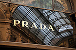 Prada brand name reflected in window of Vittorio Emanuele II Shopping Gallery, Milan, Italy