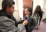 Michael Mosley helps his son AJ, 5, with his tie as they wait with daughter Josalynne, 8, for the opening day ceremonies at the Legislature in Carson City, Nev. on Monday, Feb. 7, 2011. The family was there with Assemblyman John Ellison, R-Elko. .Photo by Cathleen Allison