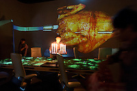 Various scenes are projected on to the walls of the dinning room at the Ultraviolet restaurant in Shanghai, China on 27th Sept 2013.  The restaurant in run by Chef Paul Pairet. <br /> <br /> Photo by Qilai Shen / Sinopix