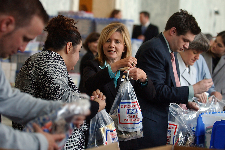 Rep. Marsha Blackburn, R-Tenn., makes a care package for a military man or woman at a 'Stuffing Party' hosted by the USO, in Rayburn.  The event resulted in 3,000 packages marked the start of National Military Appreciation Month.