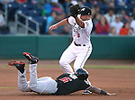 Reno Aces' Danny Worth makes the tag on Albuquerque Isotopes' Angelys Nina in a game in Reno, Nev., on Saturday, April 18, 2015. The Istotopes won 9-4. <br /> Photo by Cathleen Allison