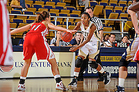 28 January 2012:  FIU guard Jerica Coley (22) handles the ball while being defended by WKU guard Ellen Sholtes (11) in the second half as the FIU Golden Panthers defeated the Western Kentucky University Hilltoppers, 60-56, at the U.S. Century Bank Arena in Miami, Florida.  Coley, who has scored the second-most points of any women's player in the country, finished the game with 36 points and surpassed the 1,000 point mark.
