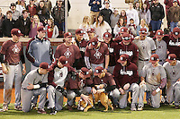 Mississippi State University baseball players pet the school mascot, Jak, during Cowbell Yell on Thursday [Feb. 9] at Dudy Noble Field. The Bulldogs will begin the 2017 baseball season at home next Friday [Feb. 17] against Texas Tech. Click here for more photos of Cowbell Yell.<br />  (photo by Kelly Price / &copy; Mississippi State University Athletics)