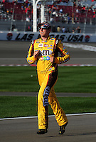 Feb. 27, 2009; Las Vegas, NV, USA; NASCAR Sprint Cup Series driver Kyle Busch runs down pit road to get in his car for qualifying for the Shelby 427 at Las Vegas Motor Speedway. Mandatory Credit: Mark J. Rebilas-