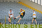 Seamus Scanlon clears the ball under pressure from Daithi Casey Dr Crokes during the O'Donoghue Cup semi final clash in Fitzgerald Stadium on Saturday