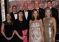 NWA Democrat-Gazette/CARIN SCHOPPMEYER Jen and James Beck (from left), Judith McKenna and Phil Dutton, Barb Putman and Peter Lane and Marjorie and Todd Hanus gather at the Walton Arts Center Masquerade Ball on Feb. 16 at the arts center in Fayetteville.