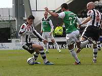 Knny McLean on the ball watched by George Francomb and Jim Goodwin in the St Mirren v Hibernian Clydesdale Bank Scottish Premier League match played at St Mirren Park, Paisley on 29.4.12.