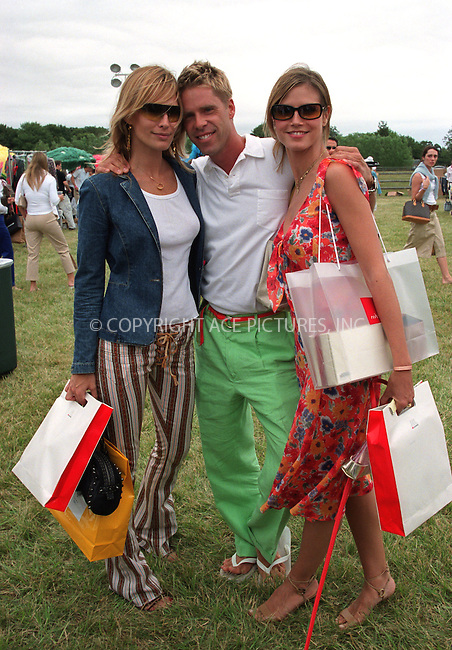"(L to R) Molly Sims, fashion photographer Stewart Shining and Heidi Klum at the Fifth Annual ""Super Saturday"" designer sale and family event to benefit the ovarian cancer research fund. Water Mill, Long Island. July 27, 2002. Please byline: Alecsey Boldeskul/NY Photo Press.   ..*PAY-PER-USE*      ....NY Photo Press:  ..phone (646) 267-6913;   ..e-mail: info@nyphotopress.com"