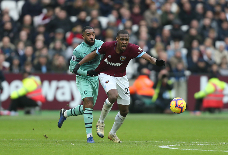 West Ham United's Issa Diop and Arsenal's Alexandre Lacazette<br /> <br /> Photographer Rob Newell/CameraSport<br /> <br /> The Premier League - West Ham United v Arsenal - Saturday 12th January 2019 - London Stadium - London<br /> <br /> World Copyright © 2019 CameraSport. All rights reserved. 43 Linden Ave. Countesthorpe. Leicester. England. LE8 5PG - Tel: +44 (0) 116 277 4147 - admin@camerasport.com - www.camerasport.com