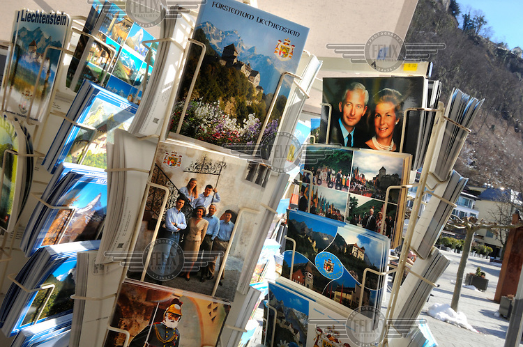 Postcards for sale in the centre of Vaduz showing members of the royal family, who have the power to veto laws, dissolve parliament and appoint judges. Liechtenstein has become a major tax haven, whose opaque banking laws are said to aid fraud, money laundering and tax evasion. There are an estimated 75,000 companies registered in the country, twice that of the population.
