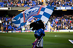 Crazee, one of the home club's mascots on the pitch with a flag before Ipswich Town play Oxford United in a SkyBet League One fixture at Portman Road. Both teams were in contention for promotion as the season entered its final months. The visitors won the match 1-0 through a 44th-minute Matty Taylor goal, watched by a crowd of 19,363.