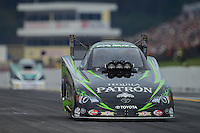 Oct. 6, 2012; Mohnton, PA, USA: NHRA funny car driver Alexis DeJoria during qualifying for the Auto Plus Nationals at Maple Grove Raceway. Mandatory Credit: Mark J. Rebilas-