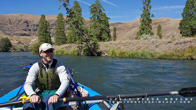 A rafter enjoys the Deschutes River near Cedar Island.