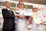 "March 8, 2013, Chiba, Japan - The chef Jeff Ramsey of the restaurant ""Tako Grill"" from USA receives the ""Gold Sushi Restaurant Award"" at the World Sushi Cup Japan 2013, Restaurant Competition in Makuhari. Word's top class Sushi Chefs from overseas and Japan attend the ""World Sushi Cup Japan 2013"" to show their creativity and inspiration for making sushi. The competition evaluates the sanitary and quality control management and methods as well as localizing taste and design. The contest was held fist time ever in conjunction with FOODEX Japan 2013. (Photo by Rodrigo Reyes Marin/AFLO).."