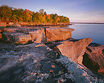 Big Bay State Park, WI:  Sunrise light on sculpted sandstone cliffs and waters of lake Superior on Big Bay Point in autumn on Madeline Island, Apostle islands, Ashland County