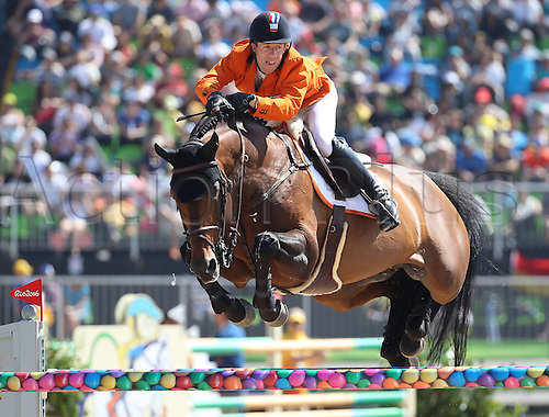 14.08.2016. Rio de Janeiro, Brazil. Maikel van der Vleuten of the Netherlands on horse Verdi clears an obstacle during the Jumping Team 1st Qualifier of the Equestrian competition at the Olympic Equestrian Centre during the Rio 2016 Olympic Games in Rio de Janeiro, Brazil, 14 August 2016.