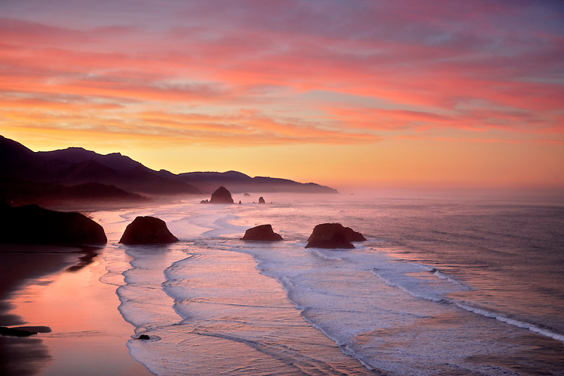 Sunrise and clouds with waves. Cannon Beach. Oregon
