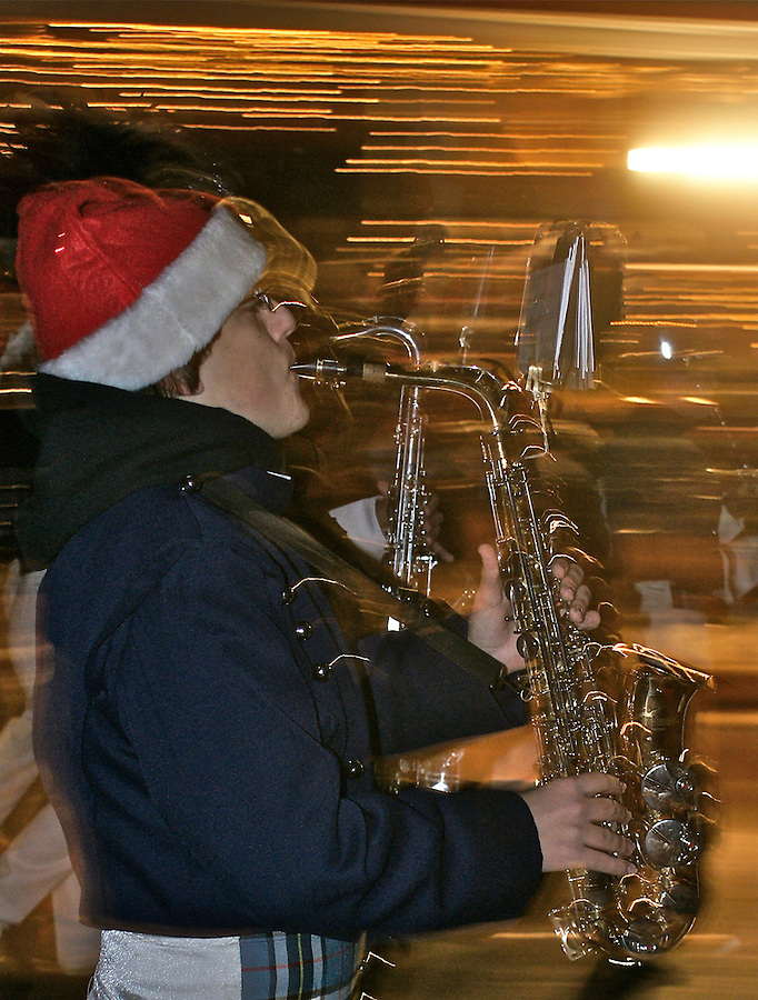 High school band member plays saxophone in Cape May Christmas parade Family activities
