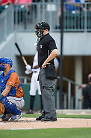 Home plate umpire Brian Peterson during the International League game between the Durham Bulls and the Charlotte Knights at BB&T BallPark on May 16, 2017 in Charlotte, North Carolina.  The Knights defeated the Bulls 5-3. (Brian Westerholt/Four Seam Images)