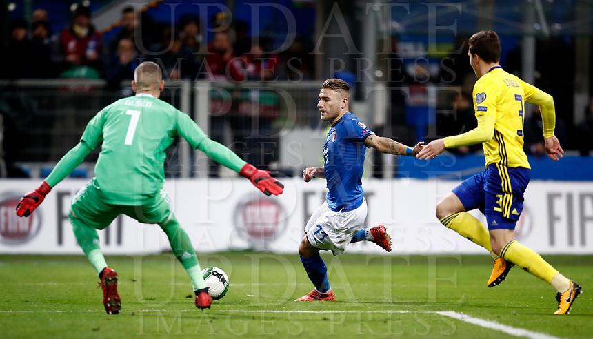Soccer Football - 2018 World Cup Qualifications - Europe - Italy vs Sweden - San Siro, Milan, Italy - November 13, 2017 <br /> Italy's Ciro Immobile (c) in action with Sweden's goalkeeper Robin Olsen (l) and Victor Lindelof (r) during the FIFA World Cup 2018 qualification football match between Italy and Sweden at the San Siro Stadium in Milan on November 13, 2017.<br /> UPDATE IMAGES PRESS/Isabella Bonotto