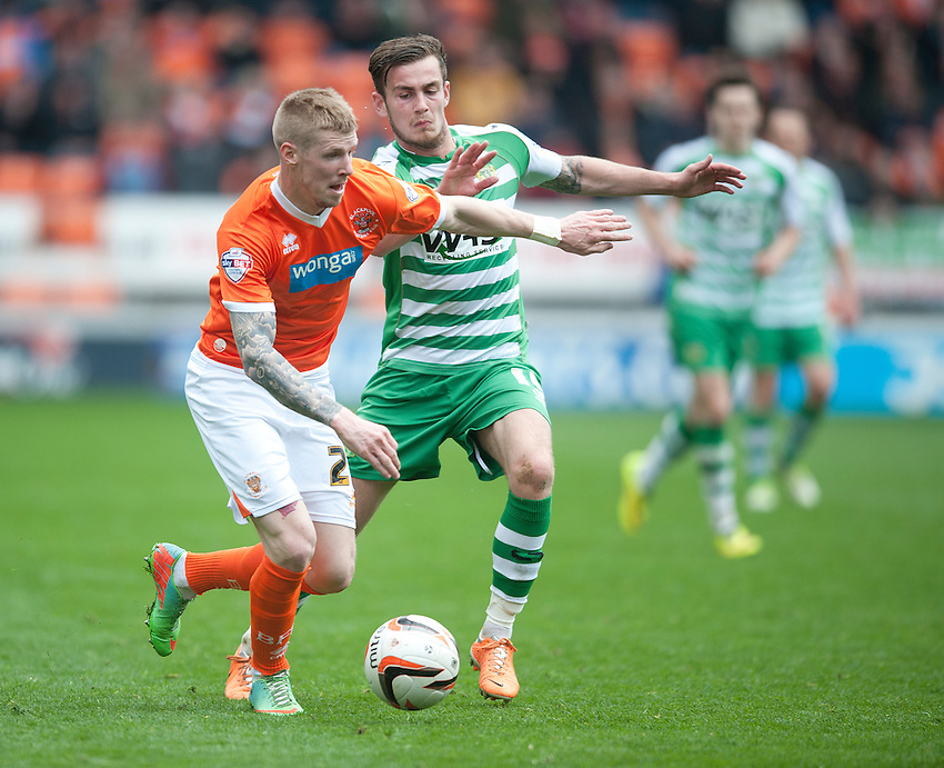 Blackpool's Andrew Keogh and Yeovil Town's Joe Ralls<br /> <br /> Photo by Stephen White/CameraSport<br /> <br /> Football - The Football League Sky Bet Championship - Blackpool v Yeovil Town - Saturday 5th April 2014 - Bloomfield Road - Blackpool<br /> <br /> &copy; CameraSport - 43 Linden Ave. Countesthorpe. Leicester. England. LE8 5PG - Tel: +44 (0) 116 277 4147 - admin@camerasport.com - www.camerasport.com
