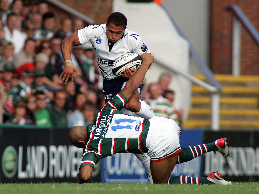 Photo: Paul Thomas..Leicester Tigers v Sale Sharks. Guinness Premiership. 03/09/2006...Sale's Jason Robinson goes over the tackle of Tom Varndell.
