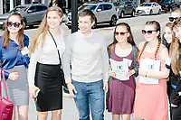 Democratic presidential candidate Pete Buttigieg poses for a picture with high school students in downtown Concord after speaking at a campaign event at Gibson's Bookstore in Concord, New Hampshire, USA, on Sat., Apr. 6, 2019. Buttigieg is the mayor of South Bend, Indiana, and was widely considered a long-shot candidate until his appearance in a CNN town hall in March 2019 which catapulted his campaign to prominence and substantial donations.