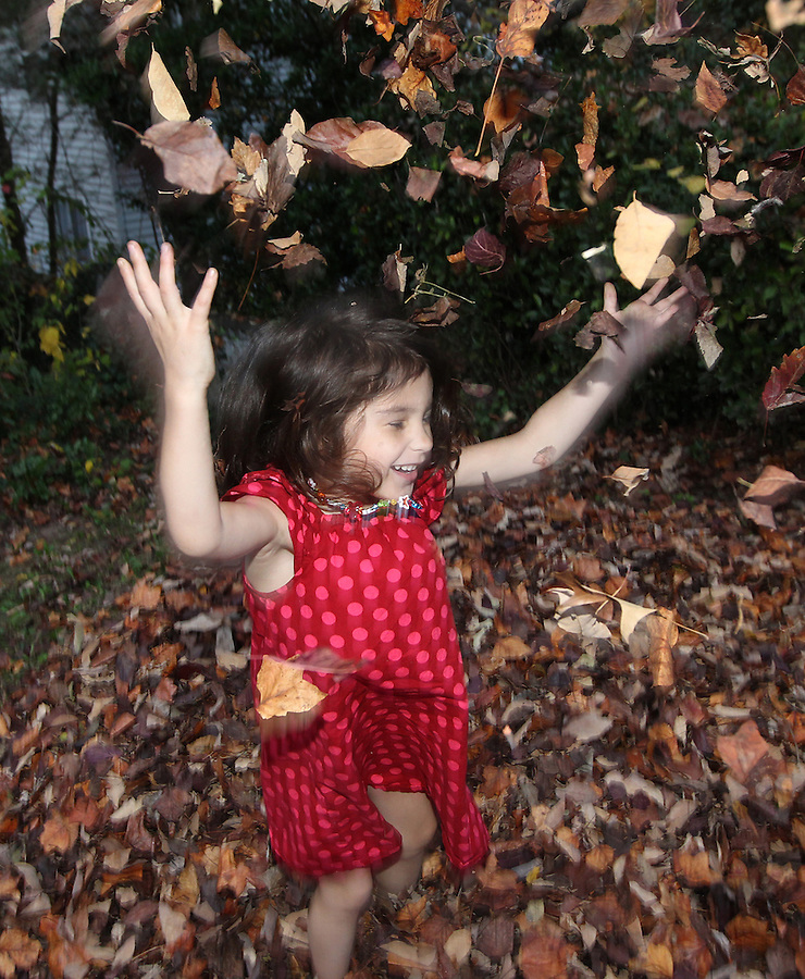 Ava, daddy and mommy jumping into the leaf pile in the front yard at home in Charlottesville, VA. Photo/Andrew Shurtleff