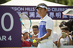 Man Wenjun plays tennis at the 10th hole during the World Celebrity Pro-Am 2016 Mission Hills China Golf Tournament on 22 October 2016, in Haikou, China. Photo by Weixiang Lim / Power Sport Images