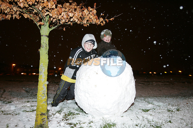 children enjoy the snow as it covered the ground with about an inch in some parts of South Louth and East Meath. Mathew Brady and Andrew McKenna starting to make there snow man in Millmount abbey in Drogheda...Photo: Newsfile/Fran Caffrey.