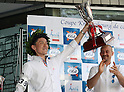 "May 22, 2016, Tokyo, Japan - Japanese waiter Daisuke Sonoda raises thr trophy as he won the ""garcon carry race"" in Tokyo on Sunday, May 22, 2016 as a  part of ""Aperitif 365"" event. 46 waiters from restaurants and cafes participated the beer carry race vying for the first prize of 300,000 yen, sponsored by French beer Kronenbourg.  (Photo by Yoshio Tsunoda/AFLO) LWX -ytd-"