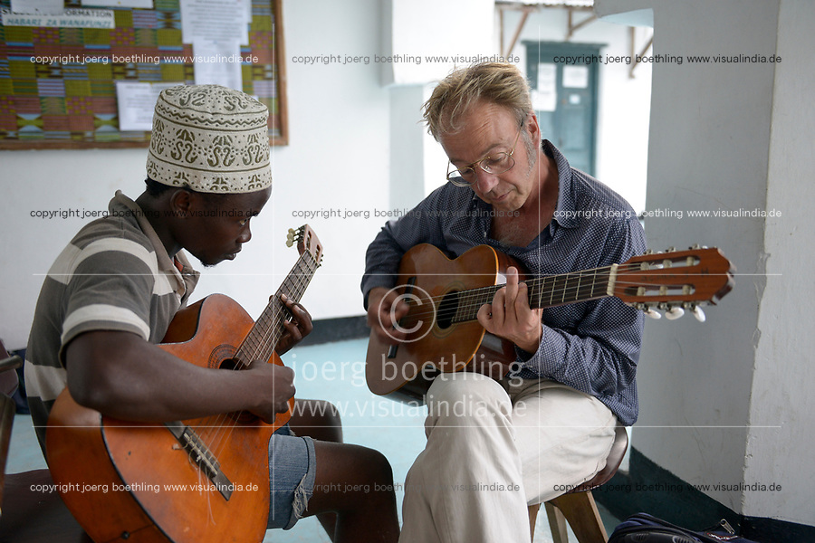 TANZANIA, Zanzibar, Stone town, Dhow countries music academy, Zanzibari music student and western guitar player play together guitar and exchange knowledge
