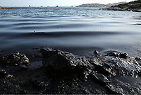 Pictured: The oil spill that has reached the coast of Salamina, Greece<br /> Re: An oil spill off Salamina island&rsquo;s eastern coast is spreading and has become &ldquo;an environmental disaster&rdquo; according to local authorities in Greece.<br /> The spill was caused by the sinking of the Aghia Zoni II tanker, carrying 2,200 metric tons of fuel oil and 370 metric tons of marine gas oil on Saturday, southwest of the islet of Atalanti near Psytalleia. According to reports, the coastline stretching from Kinosoura to the Selinia community has &ldquo;turned black&rdquo; and authorities fear a new leak from the sunken ship.<br /> According to the island&rsquo;s mayor, Isidora Papathanasiou, the weather &ldquo;turned on Sunday afternoon and brought the oil spill to Salamina.&rdquo;