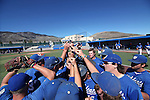The Wildcats circle up on third base before a game at Western Nevada College, in Carson City, Nev., on Friday, March 13, 2015. <br /> Photo by Cathleen Allison