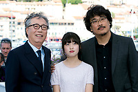 Actors Byung Heebong (L-R), Ahn Seo-Hyun and director Bong Joon-Ho attend the photocall of the movie 'Okja' during the 70th Annual Cannes Film Festival at Palais des Festivals in Cannes, France, on 19 May 2017. - NO WIRE SERVICE · Photo: Hubert Boesl/dpa /MediaPunch ***FOR USA ONLY***